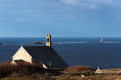 Little chapel and lighthouse at Pointe du Van Stock Photography