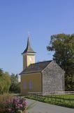 Little chapel beside the road in rural landscape Stock Photo