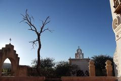 Little Chapel in the Sonoran Desert. Landscape view of Chapel next to the Mission San Xavier del Bac in Tucson, Arizona, at sunset Stock Photo