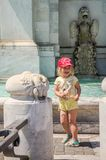 Little charming girl in a baseball cap on the Aqua Paola fountain in Rome, Italy. Little charming girl in a baseball cap on the Aqua Paola fountain in Rome Royalty Free Stock Photos