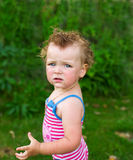 The little charming girl in a bathing suit. The little charming girl in a bathing suit on a green background Stock Photo