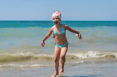Free Little Charming Girl Child Joyfully Plays On The Sea With Waves Stock Images - 156689414
