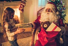 Girl with Santa Claus Royalty Free Stock Photography