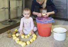 Little charming girl and potato heart. Stock Image
