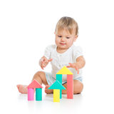 Little cheerful baby playing with construction set Royalty Free Stock Photos
