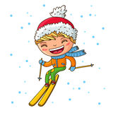 Little cheerful boy skiing in the winter Royalty Free Stock Photography