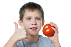 Little cheerful boy with tomato showing thumbs up isolated Royalty Free Stock Photo