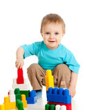 Little cheerful child with construction set. Over white background Royalty Free Stock Photography