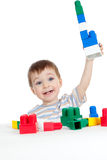 Little cheerful child with construction set stock photo