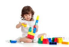 Little cheerful child with construction set royalty free stock photo