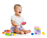 Little cheerful child with construction set Stock Image