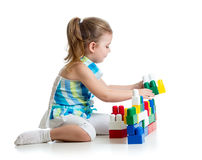 Little cheerful child with construction set over white backgroun Stock Photography