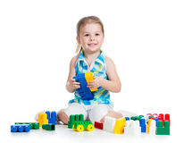 Little cheerful child with construction set over white backgroun Royalty Free Stock Photo
