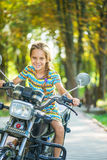 Little cheerful girl on old bike Royalty Free Stock Photography