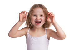 Little cheerful girl playfully scare someone Royalty Free Stock Images