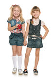 Little cheerful girls with red berries Stock Photography