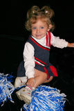 Little Cheerleader. Little girl in her cheerleading outfit with big smile and big blue eyes Stock Images