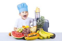 Boy making healthy juice - isolated Stock Photo