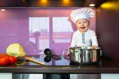 Little chef cooking in the kitchen Stock Images