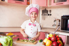 Little chef cooks in the kitchen Royalty Free Stock Photos
