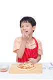 Little chef eating crab between cooking pizza Royalty Free Stock Photo