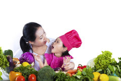 Little chef with her mother Stock Photo