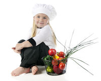 Little Chef by Her Veggies Royalty Free Stock Images