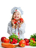 Little chef holding a tomato Stock Image