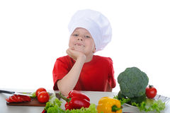 Little chef in the kitchen. Isolated on white background Royalty Free Stock Photo
