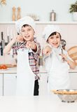 Little chef in the kitchen preparing food Stock Photography