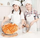 Little chef in the kitchen preparing food. This image has attached release Stock Image