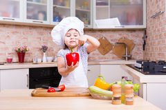 Little chef on kitchen preparing vegetables Royalty Free Stock Images