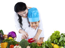 Little chef learn to cook Royalty Free Stock Images