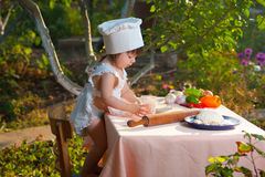 Little chef makes the dough Royalty Free Stock Images