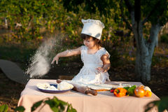 Little chef makes the dough Royalty Free Stock Photography