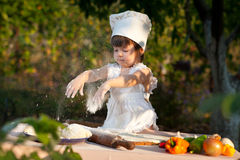 Little chef makes the dough Stock Photography