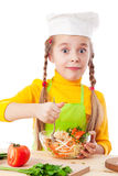 Little chef mix the salad Stock Photo