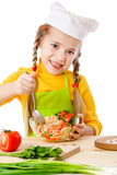 Little chef mix the salad Royalty Free Stock Photography