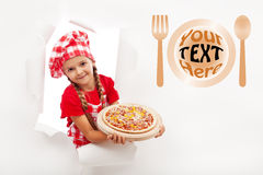 Little chef offering you a fresh pizza Stock Image