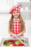 Little chef washing vegetables Stock Photography