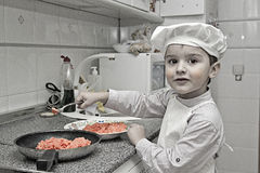 Little chef working Stock Photo