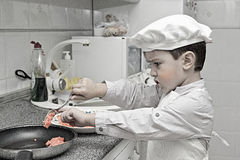 Little chef working Stock Photos