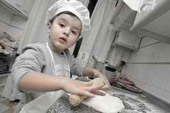 Little chef working Stock Images