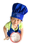 Little Chefs. A young girl having fun in the kitchen making a mess....I mean making something special..... Education, learning, cooking, childhood Stock Photo