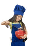 Little Chefs. A young girl having fun in the kitchen making a mess....I mean making cookies Stock Photos
