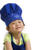Little Chefs. The little chef making a mess in the kitchen Stock Photography