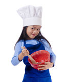 Little Chefs. The little chef making a mess in the kitchen Stock Photo
