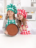 Little chefs baking a cake Royalty Free Stock Image