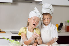 Little Chefs Baking Something in Kitchen. Missy Little Chefs Baking Something to Eat in Kitchen Royalty Free Stock Photos