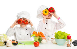 Little chefs by table with vegetables Stock Photography
